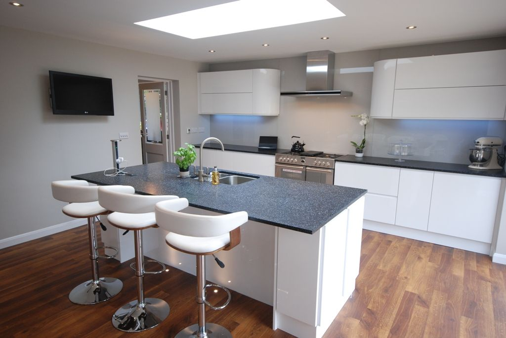 High Gloss White J Section Kitchen With Black Granite
