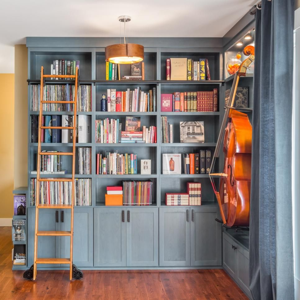 In Need Of A Home For Their Beautiful Bass And Extensive Collection Of Books And Records The Homeowners Tu Home Library Design Home Library Decor Home Library