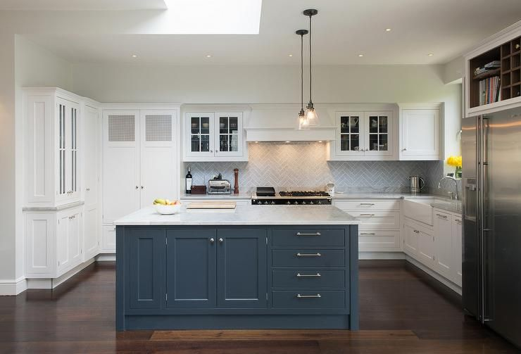 Amazing Kitchen Features Mini Glass Cone Pendants Illuminating A Blue  Center Island Topped With White And