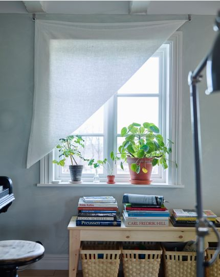A picture a window with a hung DIY curtain