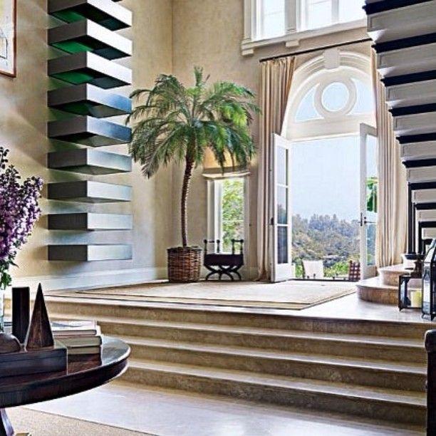 Peak inside the impressive lobby of the home of director James Burrows. #luxury #luxe #interiordesign #interiordecorating #design #homebeautiful #house #decorating #interiordetail #house