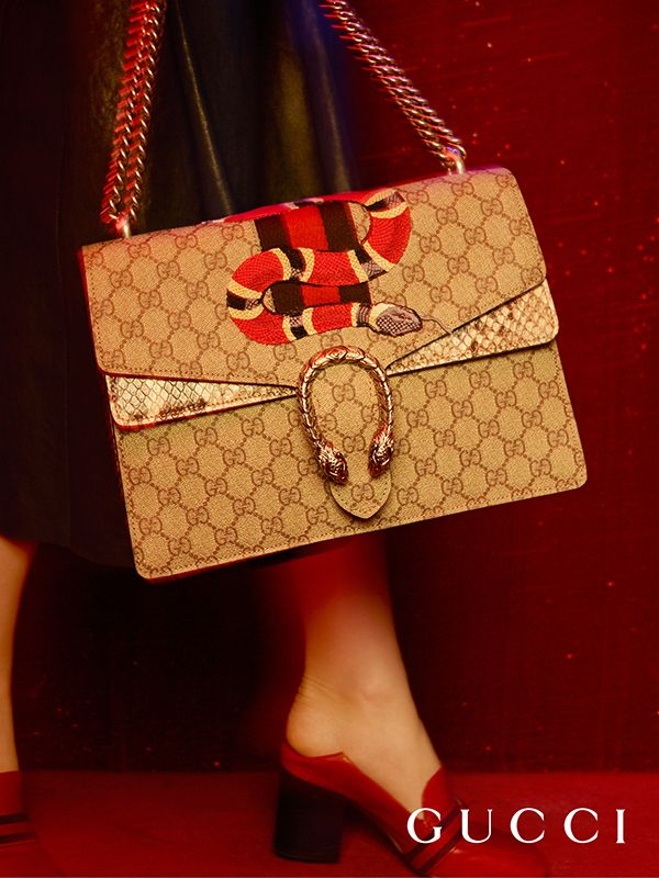 6c80cec73253 Presenting the Gucci Dionysus shoulder bag with a textured tiger head spur  closure, a snake