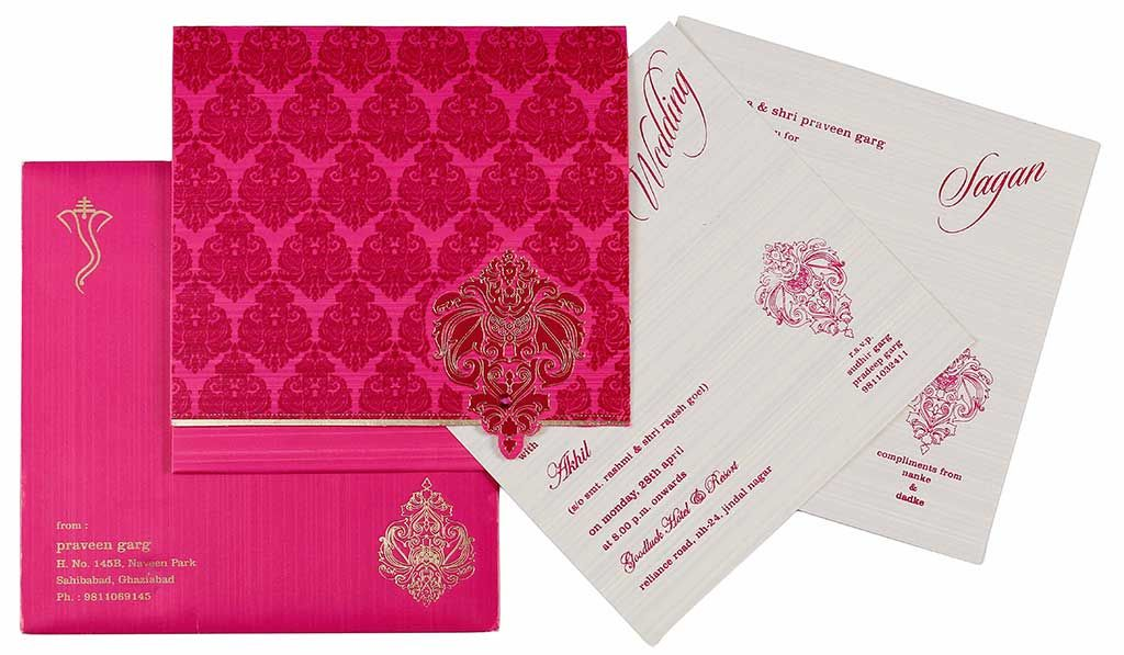 indian wedding card in magenta fuchsia golden color wedding