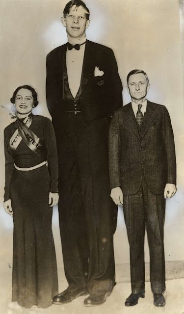 Robert Wadlow At 15 Years Off Age To His Left Is Miss Peters Shoes