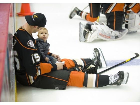 Ryan Getzlaf gets some ice time with his son Ryder James before the start of the skills competition. The Ducks placed their sad season aside Saturday for a couple hours of fun.