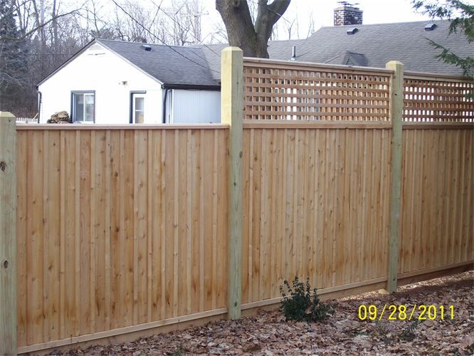 Board And Batten Wood Fence With Lattice Wood Fence Wood Fence