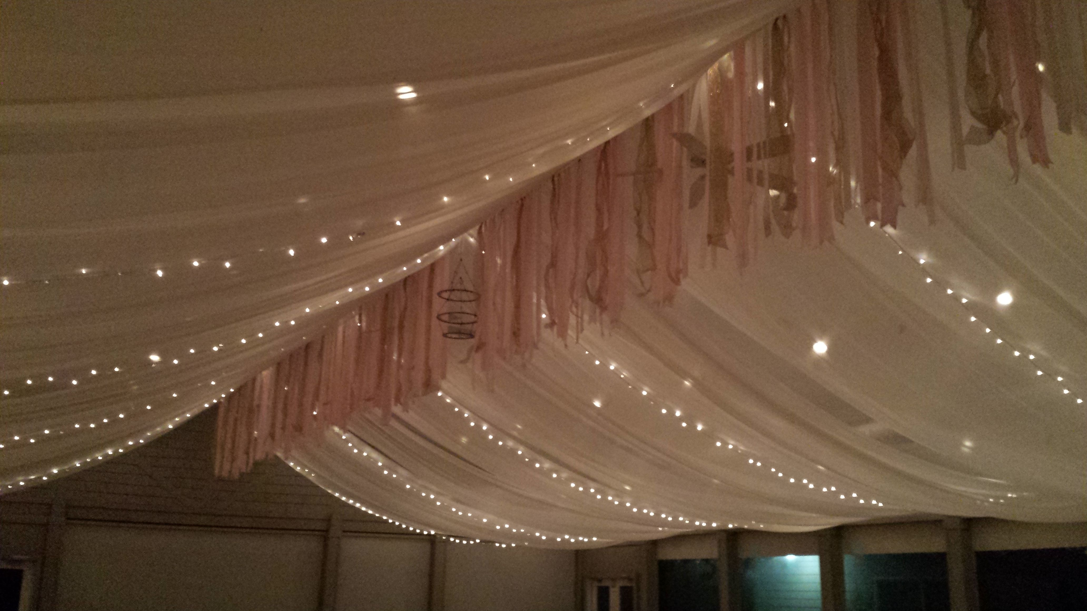 The Ceiling Fully Covered With Sheer White Fabric That Was