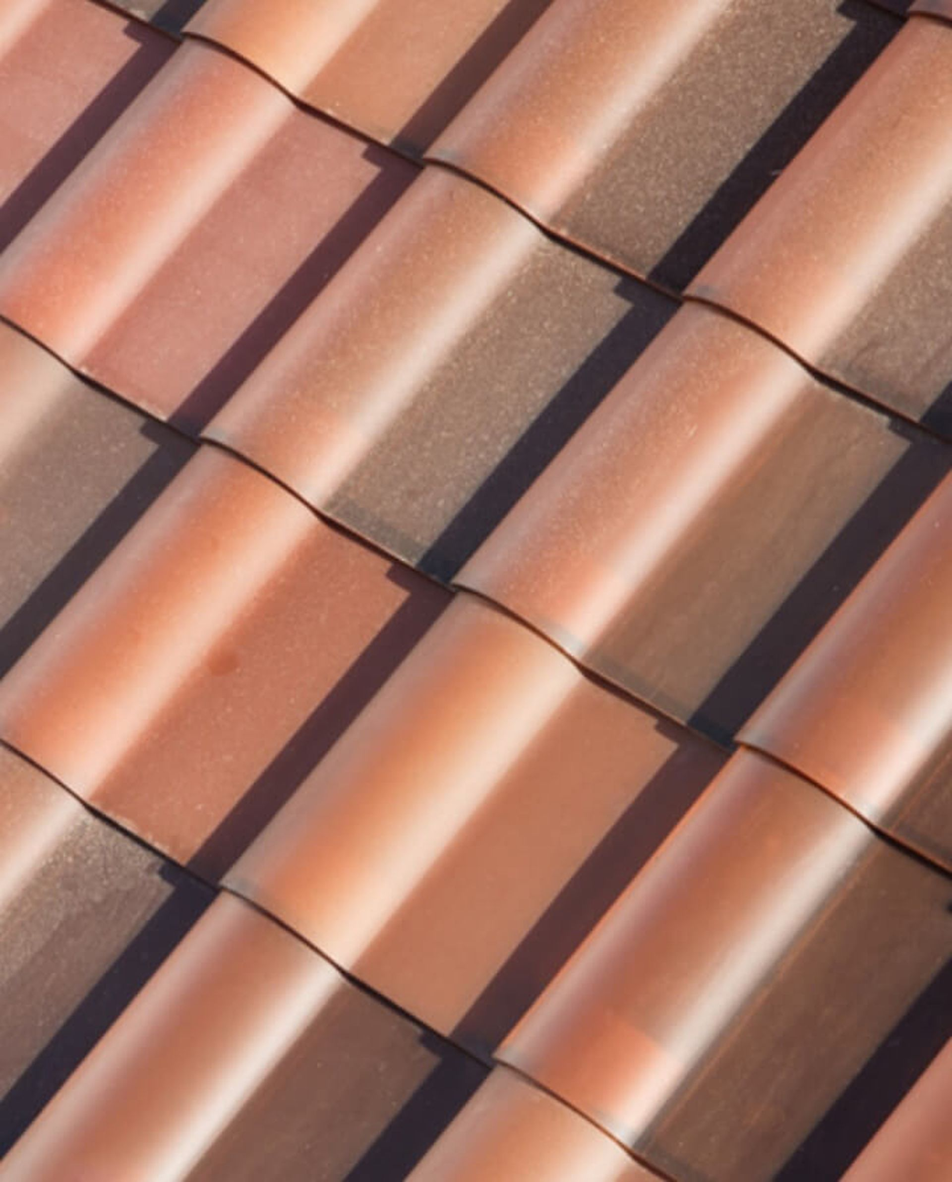 First Announced Last Fall Tesla S Solar Roof Tiles Are Made To Look Like Conventional Roofs With Styles Like Tusca Tesla Solar Roof Solar Roof Solar Shingles
