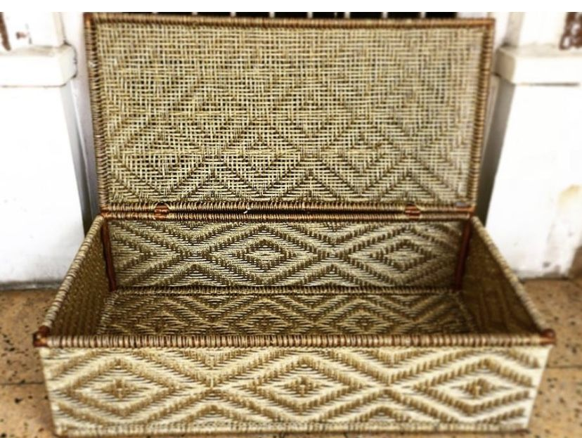 This is the Golden Bulbul storage trunk made from antique gold coir on a sturdy iron frame. The traditional design took our skilled artisans over 12 hours to weave. It's beautiful exterior makes it a perfect wedding accessory, to place into the room of the newly married couple. #wastetowow #wovenfurniture #vintagefurniture #charpoy #charpai #weaversofinstagram #sustainableliving #sustainabledesign #circulareconomy #circularfurniture #supportyourladies #surviveandthrive #sustainableliving #sustai