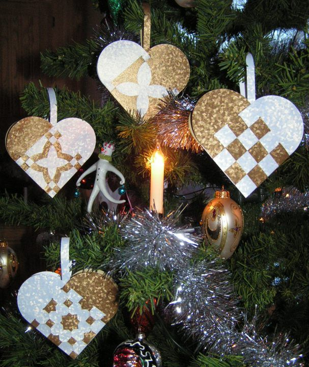 handmade ornaments ... fancy weave Scandinavian hearts ... cutting files from Monica's Creative Room ... gorgeous gold and white shimmery papers ...