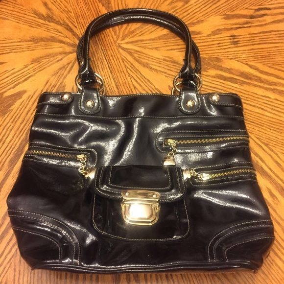 """Kathy Van Zeeland Black Patent Leather Handbag The perfect mix of classic with contemporary design by Kathy Van Zeeland Faux  Black Patent Leather Purse Gold Zippers And Gold Clips. 2 Large Sides With Large Inner/Middle Zipper (see pictures) Pocket. 3 Smaller Pockets (cell holder). Lining clean and intact no holes. Double straps 14"""" wide 10"""" high 10"""" strap drop.                                                         #1601041 Kathy Van Zeeland Bags"""