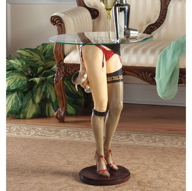 """Seamed stockings, red garters, and strappy red heels combine to demand attention in this retro work of decorative art for home or gallery. The 3/8"""" thick, pencil-edged, 18"""" dia. tempered glass tabletop balances on a sturdy fulcrum while our sexy miss tips her champagne glass."""