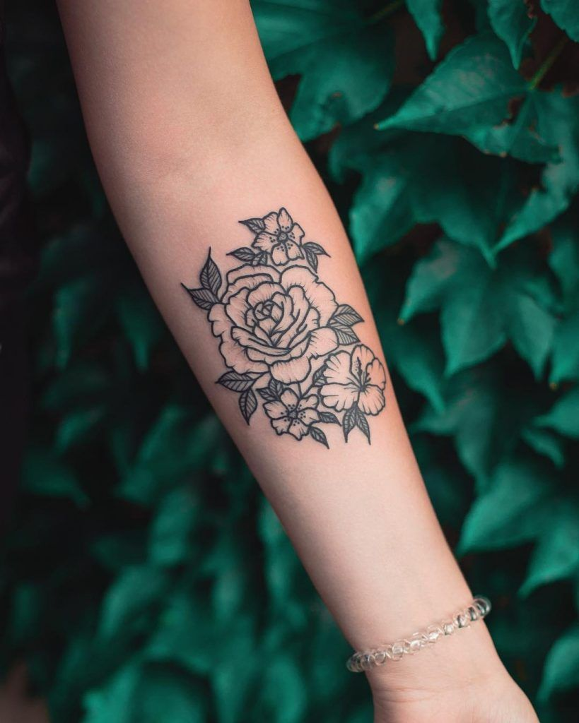 Minimalist Flowers By Dzudi Bazgrole Tattooed On The Left Forearm Tattoos For Women Small Unique Wrist Tattoos Tattoos