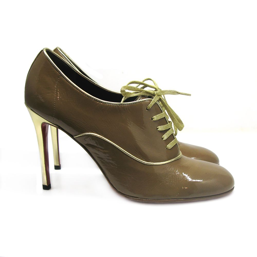 1cb70a2fd73 Sold out Christian Louboutin Miss Fred Tacco ankle boots featuring gold  lace-up ties