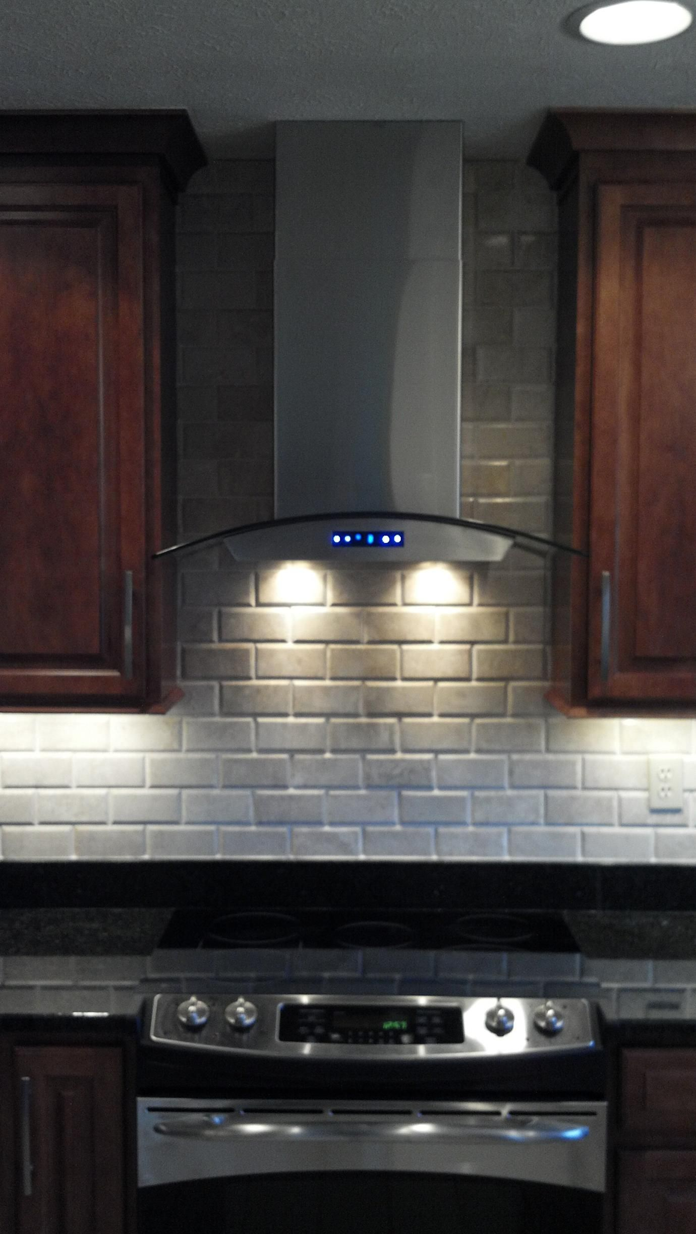 range hood with cabinets on each side  but add spacing in