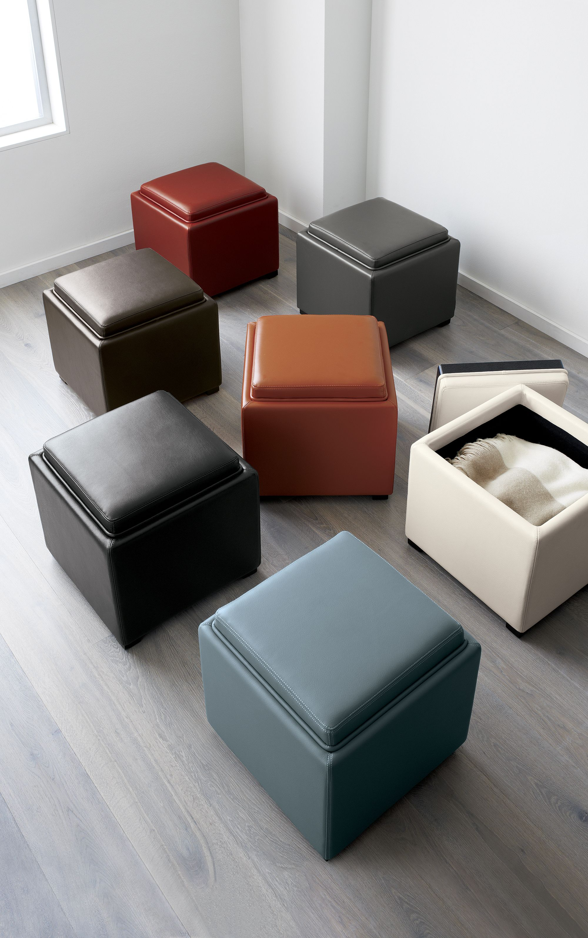 Stow is a concealed storage cube in soft, pebbled bonded leather that does stylish double-duty