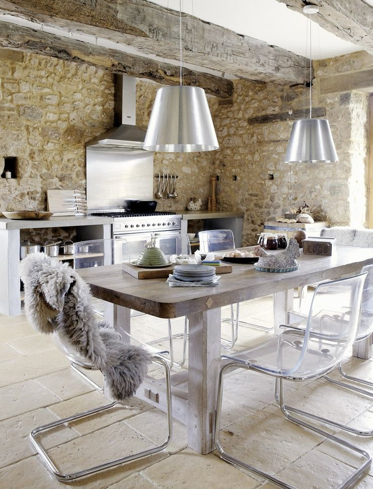 Amazing stone work combined with the exposed beams and the stark modern furnishings make this a really interesting space. Very french farm house meets tribecca loft.