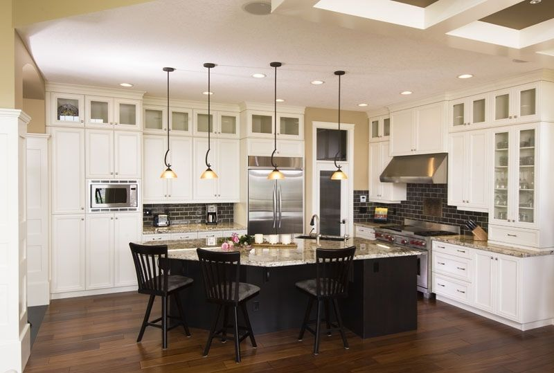White Kitchen Dark Island sharp contrast – the white cabinets and the dark centre island in