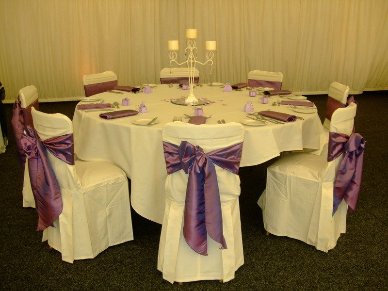 with matching taffeta napkins with cream pleated cotton chair covers