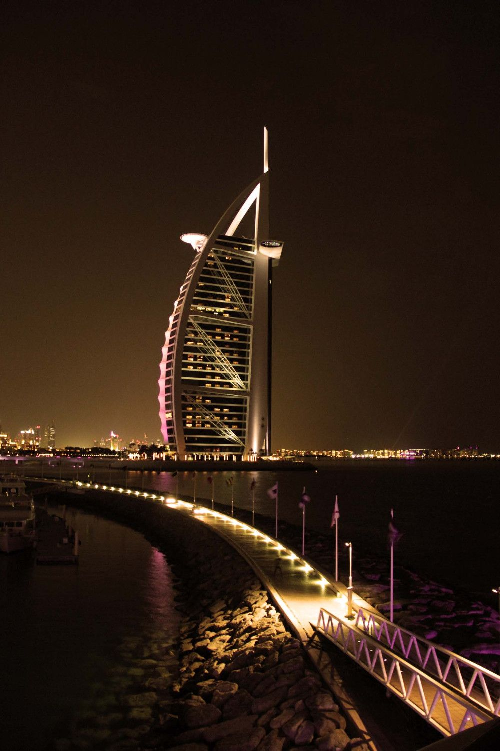when you go Dubai sightseeing, you can't miss the Burj Al Arab. This local's guide to Dubai, UAE includes all the Dubai tourist attractions and off the beaten path things to do in Dubai, as weel as Dubai accommodation options, Dubai food, and Dubai tips. #dubai #dubaiguide #dubaitravelguide #dubaiattractions #dubaithingstodo #travel #uae #dubaitips