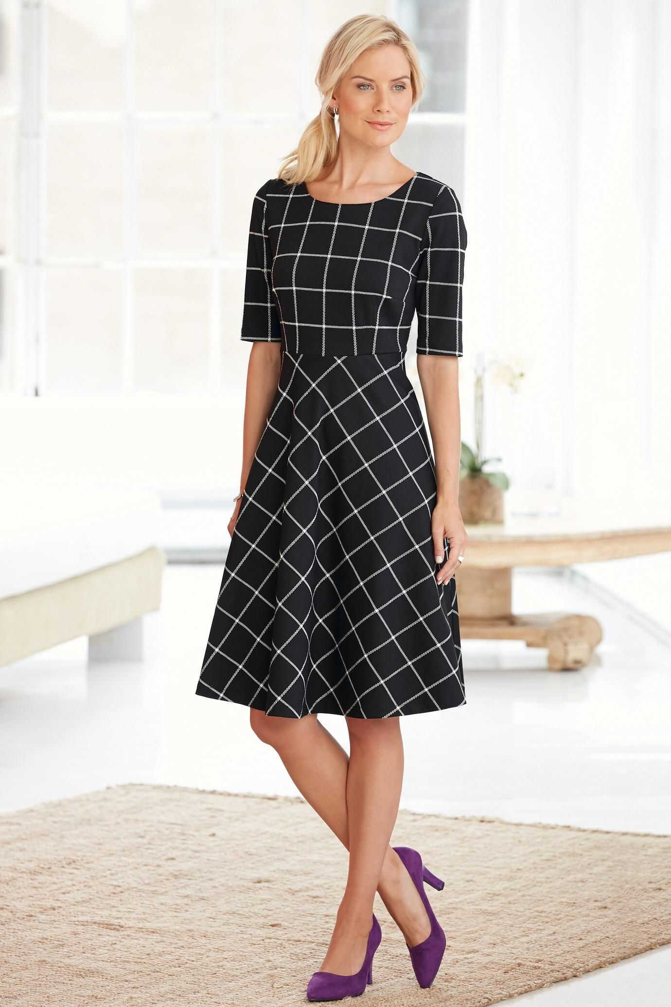 bc3beb5ea253 Short Sleeve Ponte Knit Fit & Flare Dress in a classic black & white  pattern.