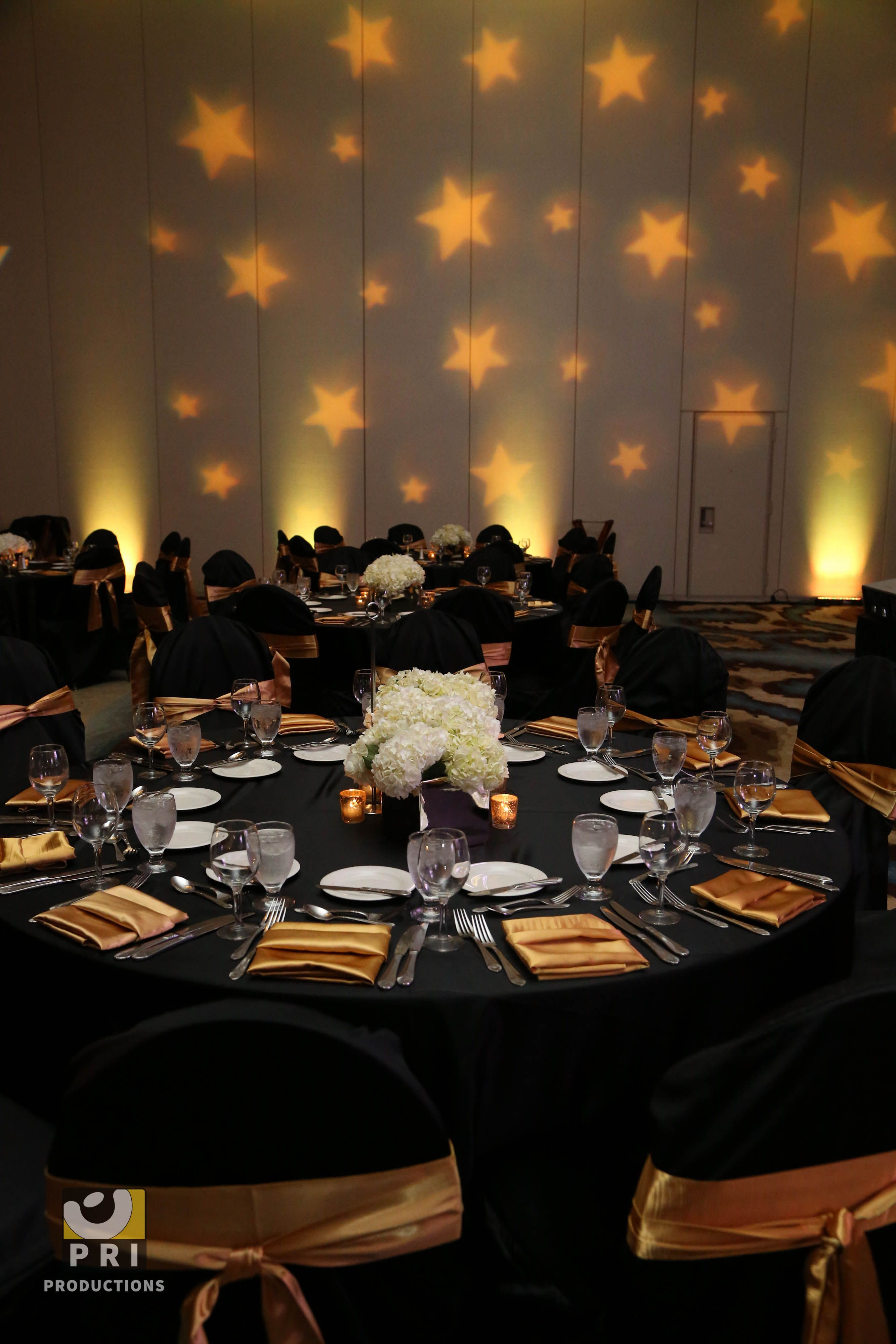 Custom star gobo lighting projected on a wall during an for Award decoration