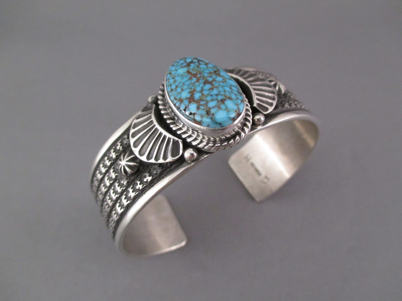 bec47c7b651 A single Kingman Turquoise stone highlights this very attractive sterling  silver cuff bracelet by Native American (Navajo) jeweler, Guy Hoskie.  Turquoise!