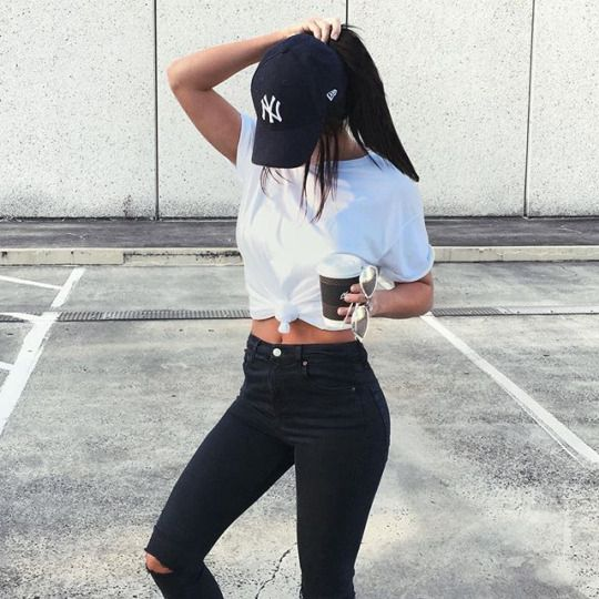 de5576329f obsessed with this casual outfit! black ripped skinny jeans + white t shirt  + baseball cap