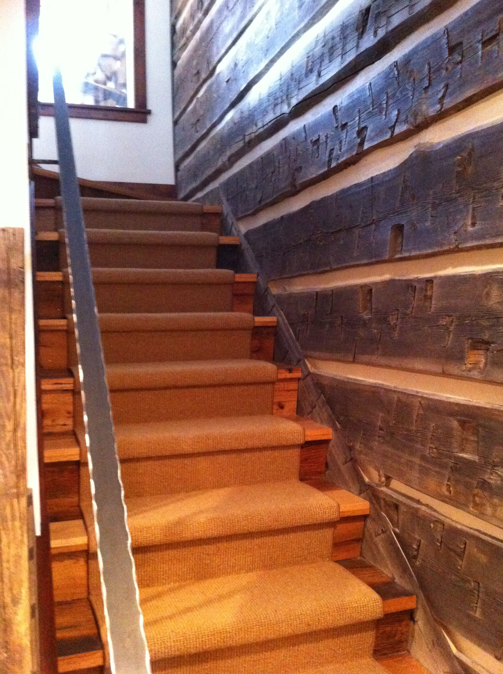 A Custom Made Distressed Metal Hand Rail, Reclaimed Oak Stair Treads And  Neutral Carpet Runner