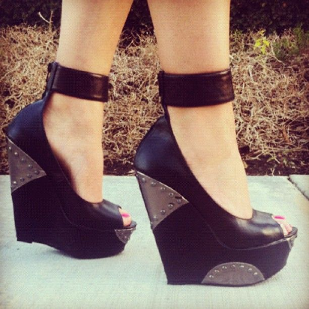 Tough love. Go jane leather wedges with strap.