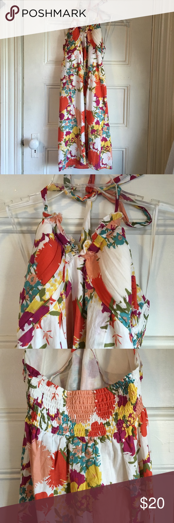 """Floral Halter Dress White floral dress with a self-tie halter and smocked back. Bust is padded. 28"""" from top to hem. Fully lined. Gorgeous floral pattern with a white base and pops of green, real, yellow, orange, light pink, and purple. Juniors size medium Dresses Mini"""