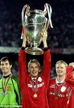 Beckham holds aloft the Champions League trophy