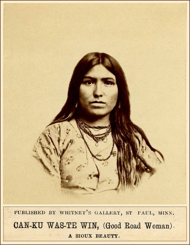 Photo of Sioux woman, CAN-KU WAS-TE WIN (Good Road Woman), wearing dress and necklaces. -…