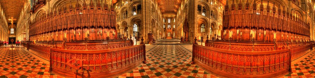 The hand-carved wooden choir stalls on Peterborough Cathedral lead the way to the spectacular central tower. The figures carved in the stalls depict historical characters from the founders of the Abbey.