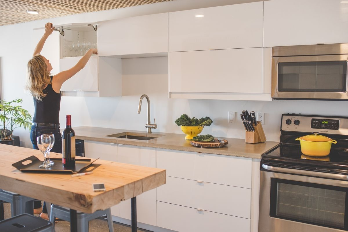 Modern Style Ikea Kitchen In Yellowknife Canada Features White High Gloss Ringhult Doors Stainles Upper Kitchen Cabinets One Wall Kitchen White Ikea Kitchen
