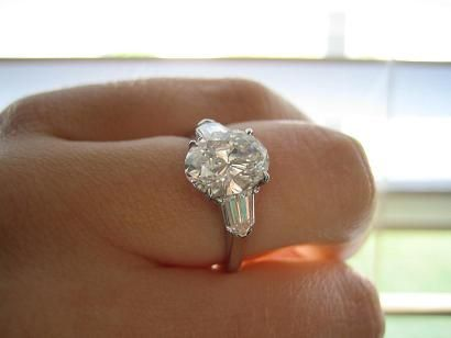 Oval 2 Carat Engagement Ring With Bullet Side Stones