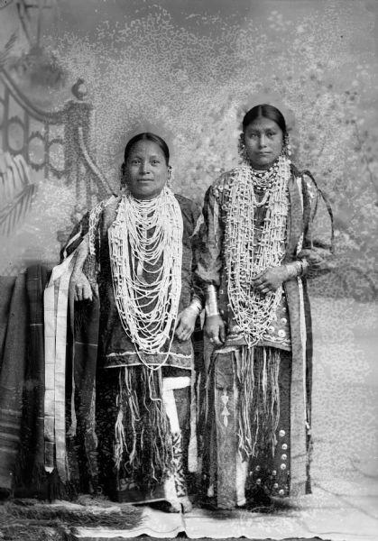 Two Ho-Chunk women in fancy dress.