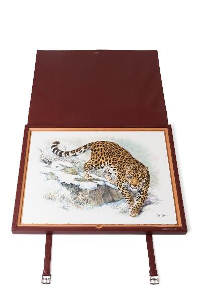 Panthera founder Tom Kaplan picked out three  Dallet gouaches (a leopard, a snow leopard and a Siberian tiger) reproduced as lithographs and displayed in a Hermès calfskin portfolio with equestrian buckle strap.