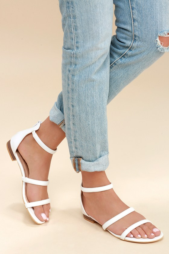 5ea500b19 The Lulus Quin White Flat Sandals are leading the pack in classic style!  Sleek vegan leather makes up these essential flat sandals including a  peep-toe ...