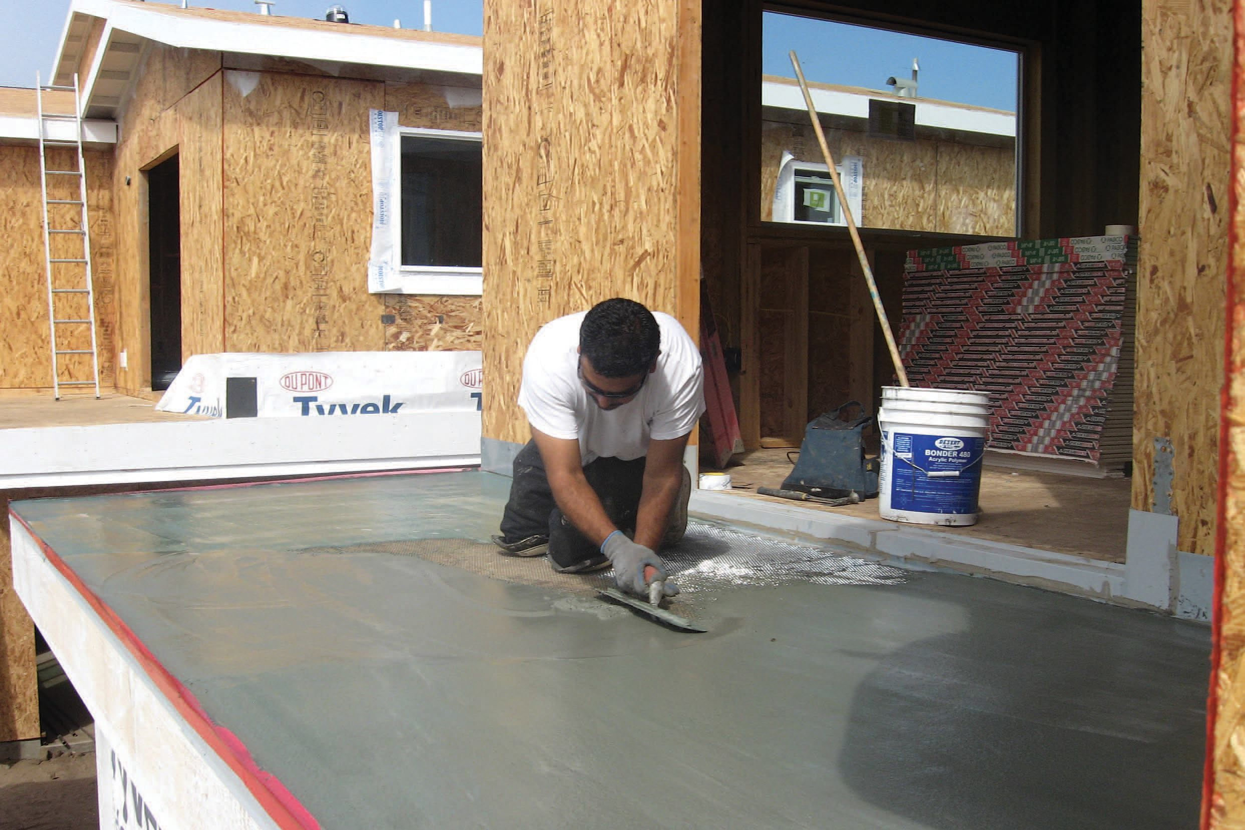 Dry Deck Over Living Space. A Multilayer Cementitious Coating Provides A  Walkable Waterproof Surface With A Class A Rating.