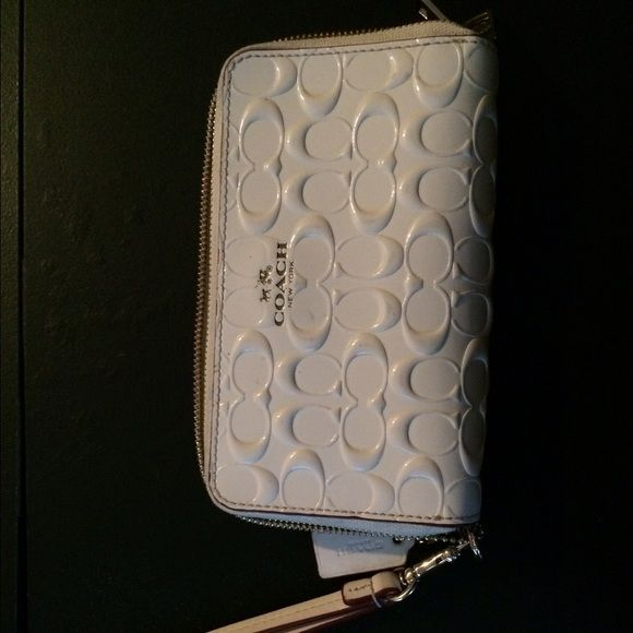 Coach Wristlet Cute Coach Wristlet... Cream  colored .. 10 card slot , zipped compartment. Bill compartments . Has a very small stain on the front that can be removed with a damp cloth . Normal sings of wear. No tears , holes or discolorations . Great condition .  5 1/2 inches long .. 3 inches wide ... Coach Bags Clutches & Wristlets
