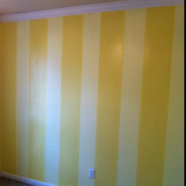 Vertical stripes painted on accent wall in the spare bedroom. Just ...