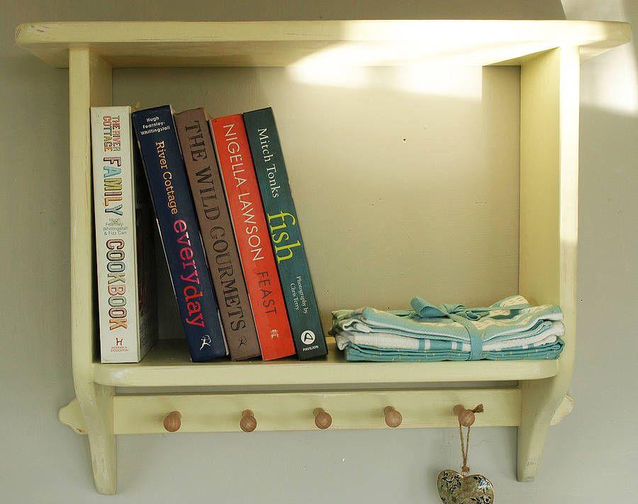 cute little book shelf with hooks
