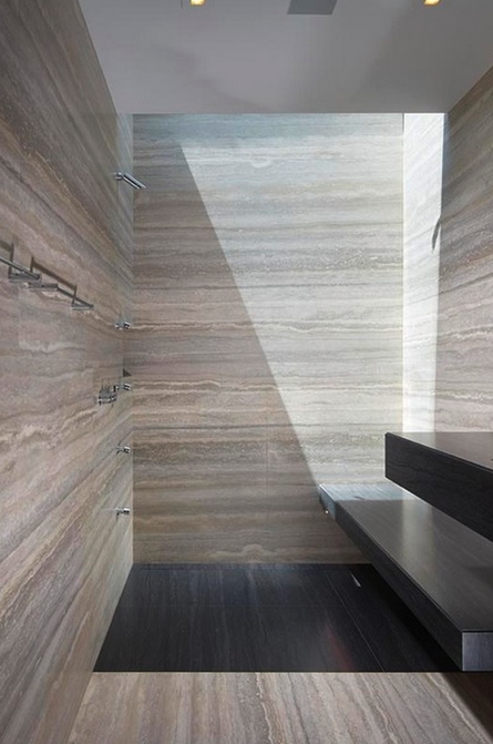 Bathroom with grey travertine walls, the Liane Lane private residence in  California by Horst Architects