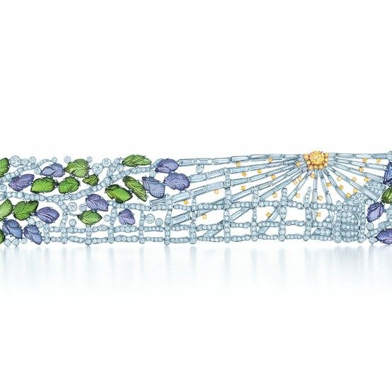 Rays of morning sun illuminate a bracelet of hand-carved tanzanites and tsavorites paired with Tiffany Yellow Diamonds and white diamonds.