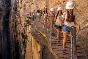MALAGA, SPAIN - APRIL 01: Tourists walk along the 'El Caminito del Rey' (King's Little Path) footpath on April 1, 2015 in Malaga, Spain. 'El Caminito del Rey', which was built in 1905 and winds through the Gaitanes Gorge, reopened last weekend after a safer footpath was installed above the original. The path, known as the most dangerous footpath in the world, was closed after two fatal accidents in 1999 and 2000. The restoration started in 2011 and reportedly cost 5.5 million euros. (Photo…