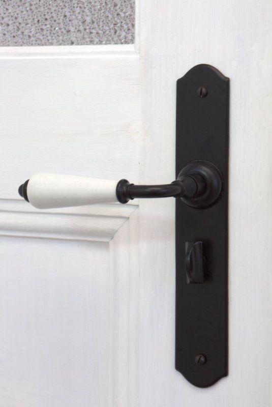 Black Lever Door Handle With White Porcelain. Http://www.restorationonline.