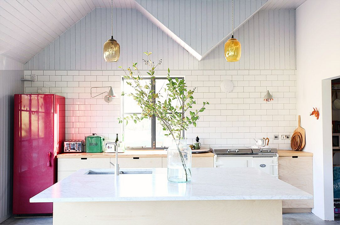 White kitchen with red refrigerator