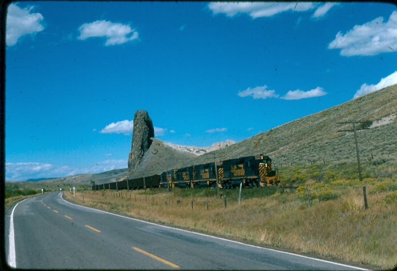 Coal loads are leaving the Yampa Valley in the care of 5346, 5360, 5355, 5371. The train is just north of Toponas, CO passing Finger Rock on September 17, 1975
