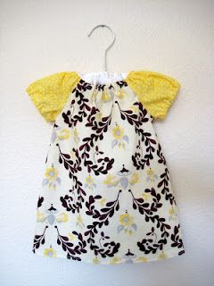 A pretty little baby dress, made using a free pattern from Sew Much Ado.